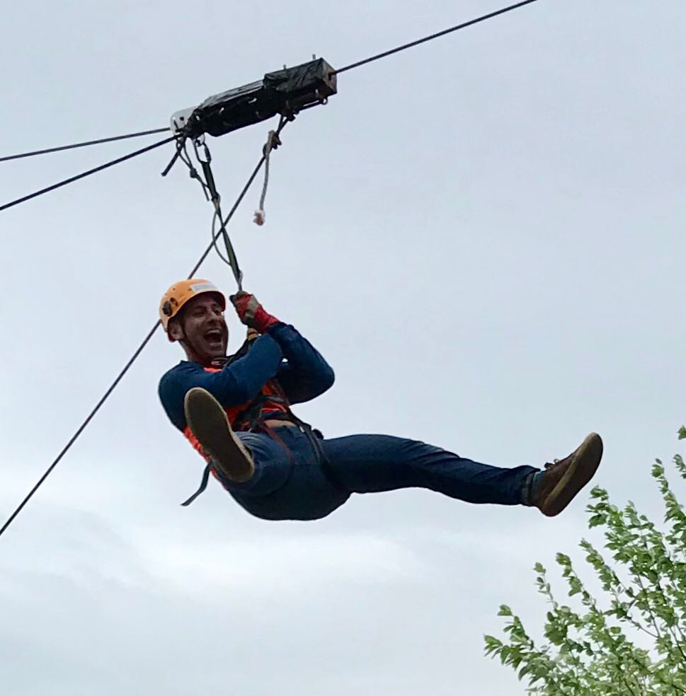 a man zipslides on a wire
